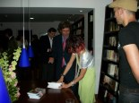 Signing a book for Dr. Freddy Sanabria