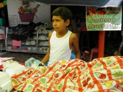 young man selling lechona in Tolima