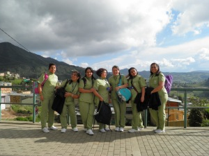 a group of beauty school students stop by to check on the progress.