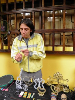 man making jewelery