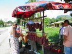 buying fruit at the side of the road