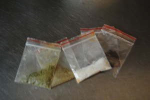 these tiny little bags actually contain some innoculous spices; salt, oregano, red pepper and black pepper