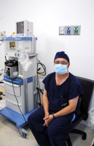 Dr. Julio Arrango keeps a close eye on his patient
