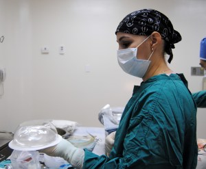 Monica prepares a prosthesis for implantation