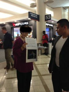 Woman soliciting signatures for United Nations petition against organ harvesting