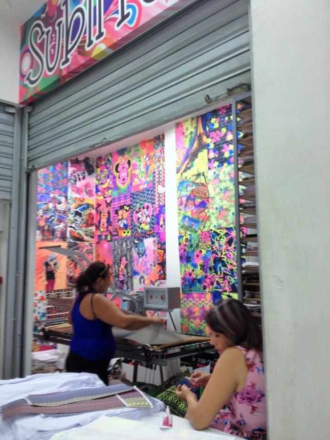 small storefront.. the lady in the blue tank is printing custom fabric