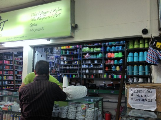 small shop in an indoor fabric mini-mall selling thread