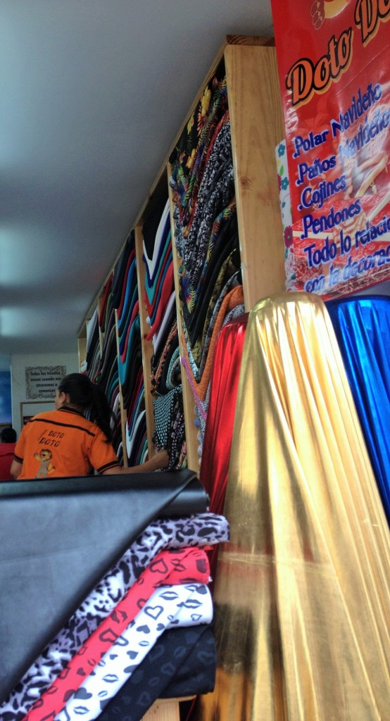 many shops are small but piled high with fabric