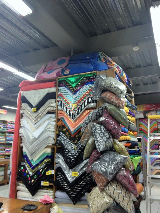 displays piled high with fabric