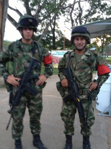 Miguel (forefront) from the Colombian military patrols La Macarena